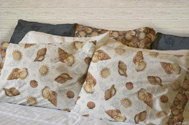 seven pillows with white pillowcases