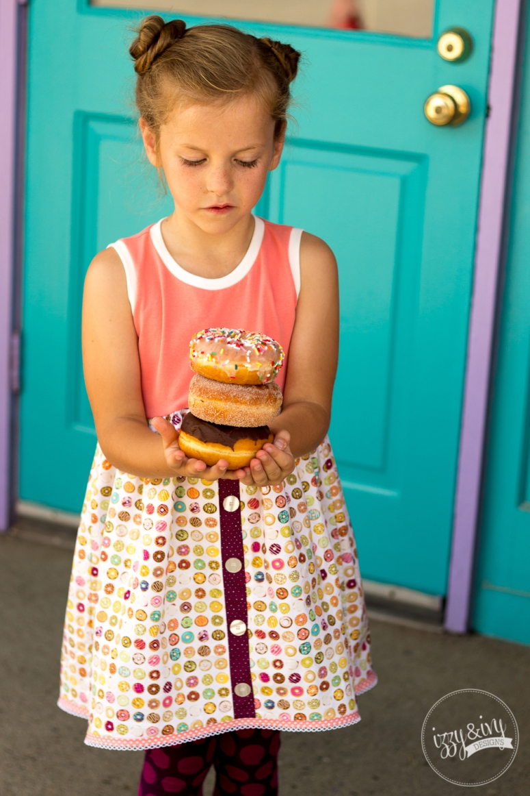 1_caf-fiend-donut-dress_holding-stack-of-donuts