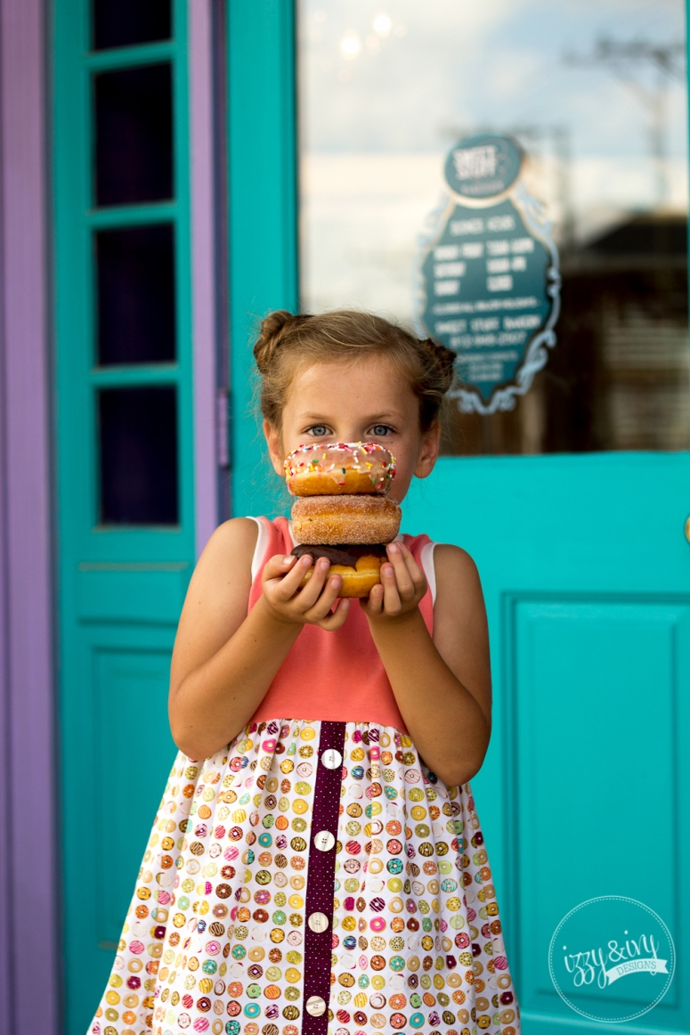 5_caf-fiend-donut-dress_stack-of-donuts-infront-of-face